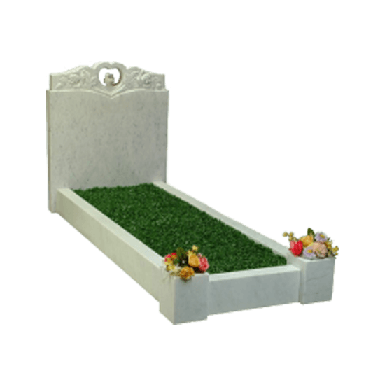 White Marble Cut Through Headstone Memorial with Kerbs and Carving