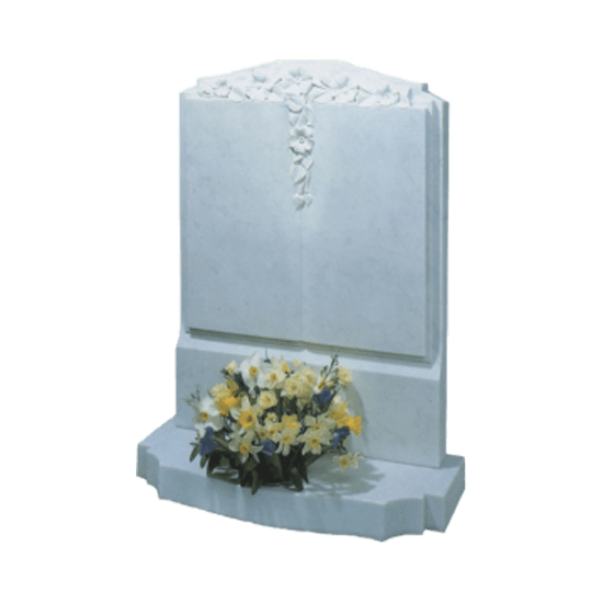 White Marble Headstone and Base Memorial with Carved Book and Flowers
